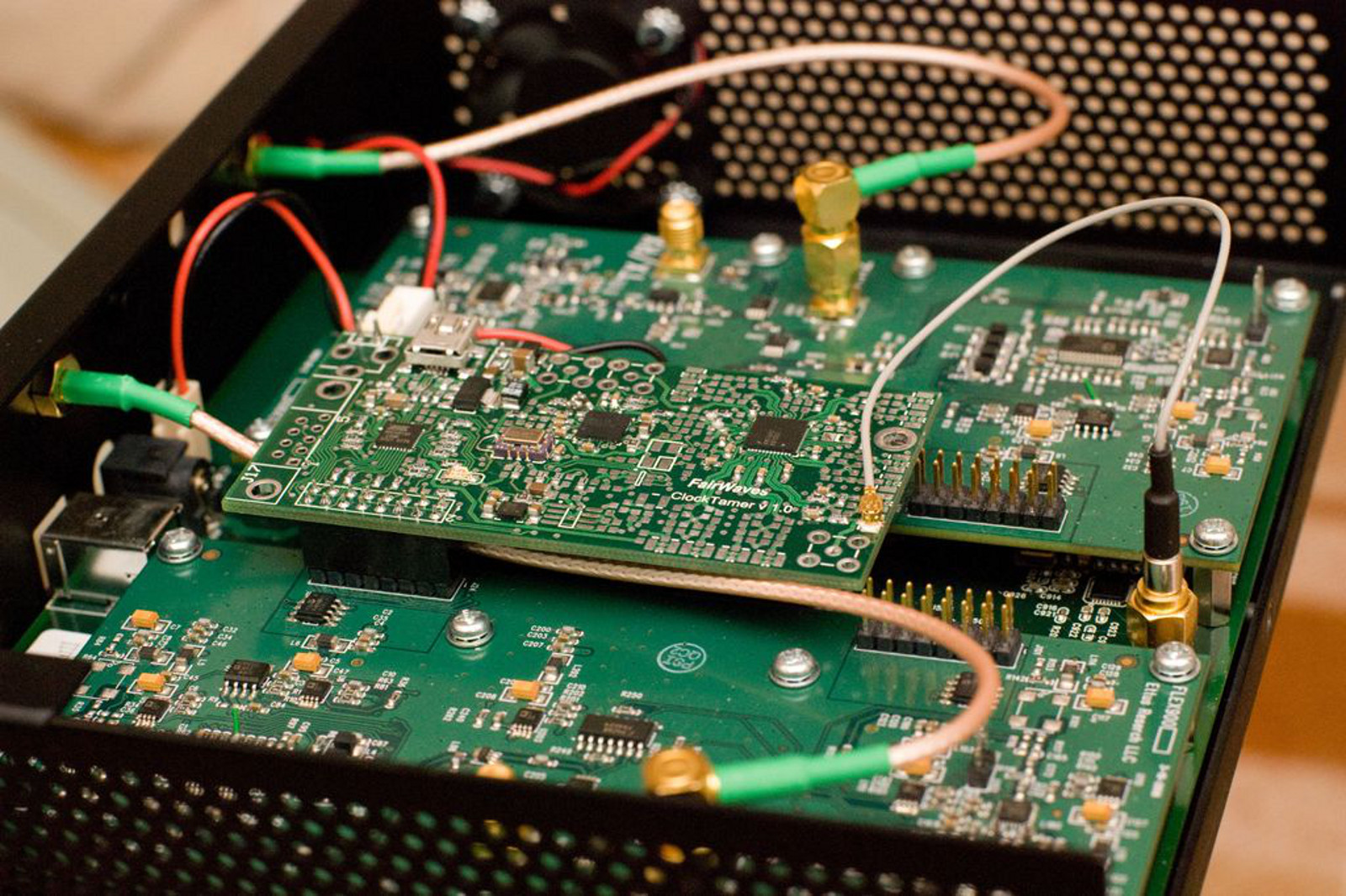 A ClockTamer v1.0 board fitted to a USRP